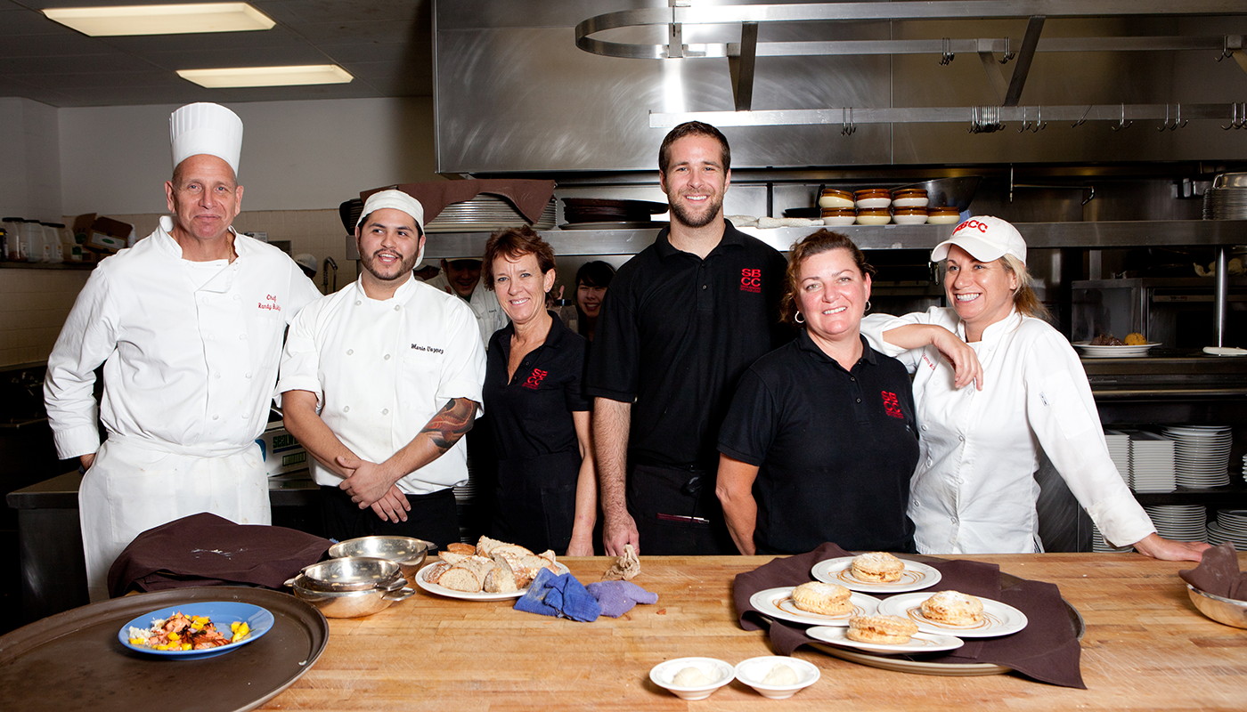 Santa Barbara City College Culinary Arts instructors pose in the kitchen.